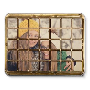 Foto op Chocolade blokjes in blik - 35 stuks