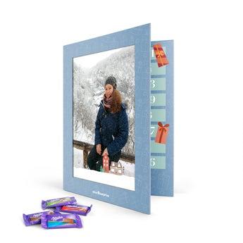 Joulukalenteri kuvalla ja tekstillä