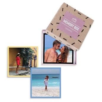 Fotografias instantâneas em caixa de presente